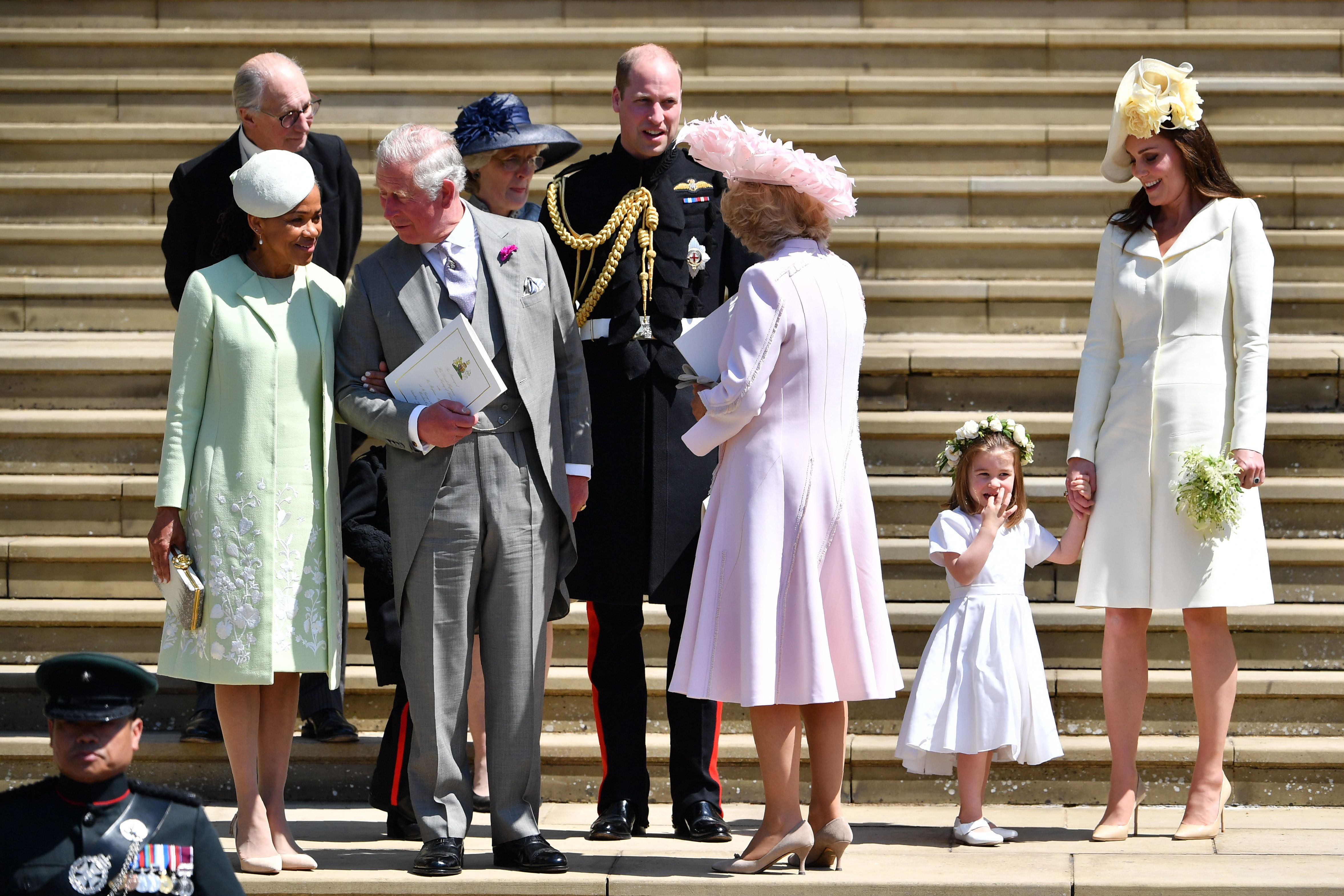 WINDSOR, UNITED KINGDOM - MAY 19:  (L-R) Doria Ragland, Prince Charles, Prince of Wales, Jane Fellowes, Prince William, Duke of Cambridge, Camilla, Duchess of Cornwall, and Catherine, Duchess of Cambridge holding her daughter Princess Charlotte's hand as they leave from the West Door of St George's Chapel, Windsor Castle, in Windsor on May 19, 2018 in Windsor, England. (Photo by  Ben STANSALL - WPA Pool/Getty Images)