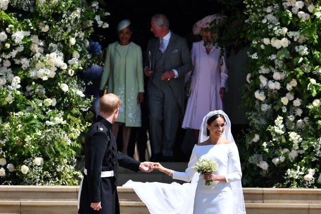 Harry turns around to find his father Charles taking good care of Meghan's