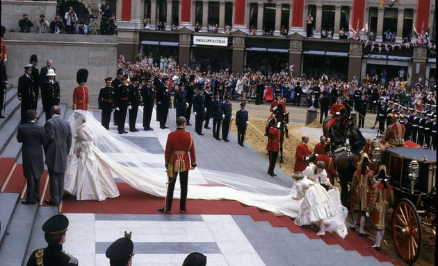 Diana, Princess of Wales, wearing an Emanuel wedding dress, enters St. Paul's Cathedral on the hand of...