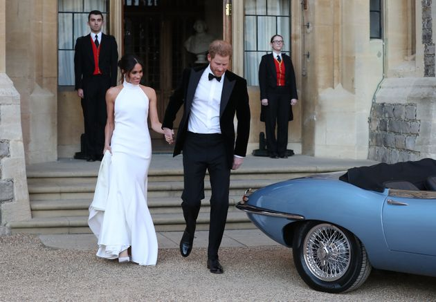 Harry helped his bride into a blue Jag before they set off to a private