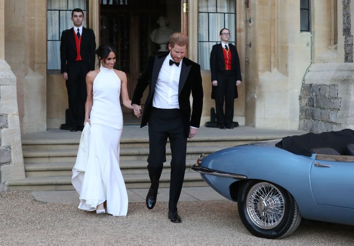 Harry helped his bride into a blue Jag before they set off to a private reception.