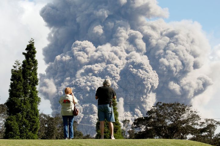 People watch ash erupt from the Halema'uma'u Crater on Saturday.