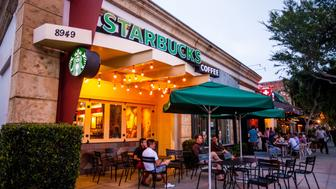 West Hollywood, USA - June 1, 2013: People sitting at Starbucks Coffee in West Hollywood, USA, located on Santa Monica Boulevard, One third of population in West Hollywood are identifying themselves as gay