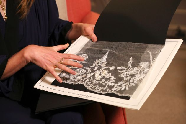 Clare Waight Keller, designer at Givenchy, holds lace as she gives an interview the day after the Duchess...