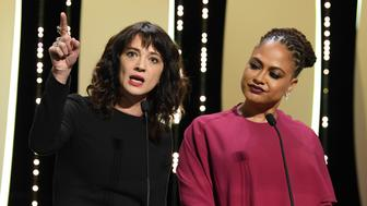 CANNES, FRANCE - MAY 19:  Asia Argento raises her arm (L) as Jury member Ava DuVernay (R) watches on stage during the Closing Ceremony at the 71st annual Cannes Film Festival at Palais des Festivals on May 19, 2018 in Cannes, France.  (Photo by Pascal Le Segretain/Getty Images)