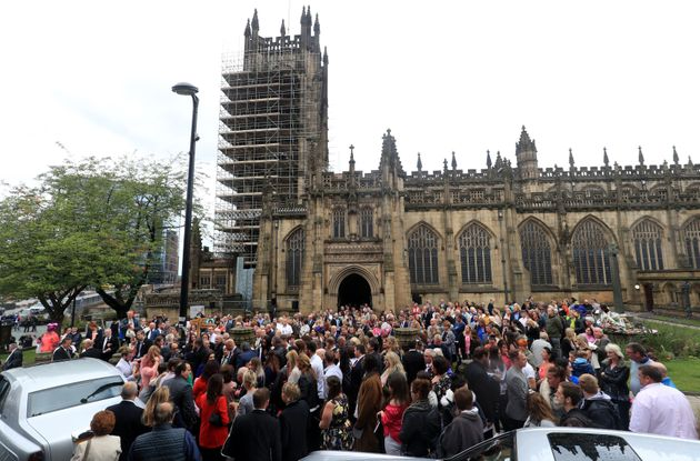 Mourners outside Manchester Cathedral after the funeral service of Saffie Roussos, who died in the arena