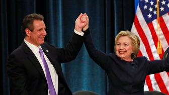 U.S. Democratic presidential candidate Hillary Clinton and New York  Governor Andrew Cuomo (L) stand