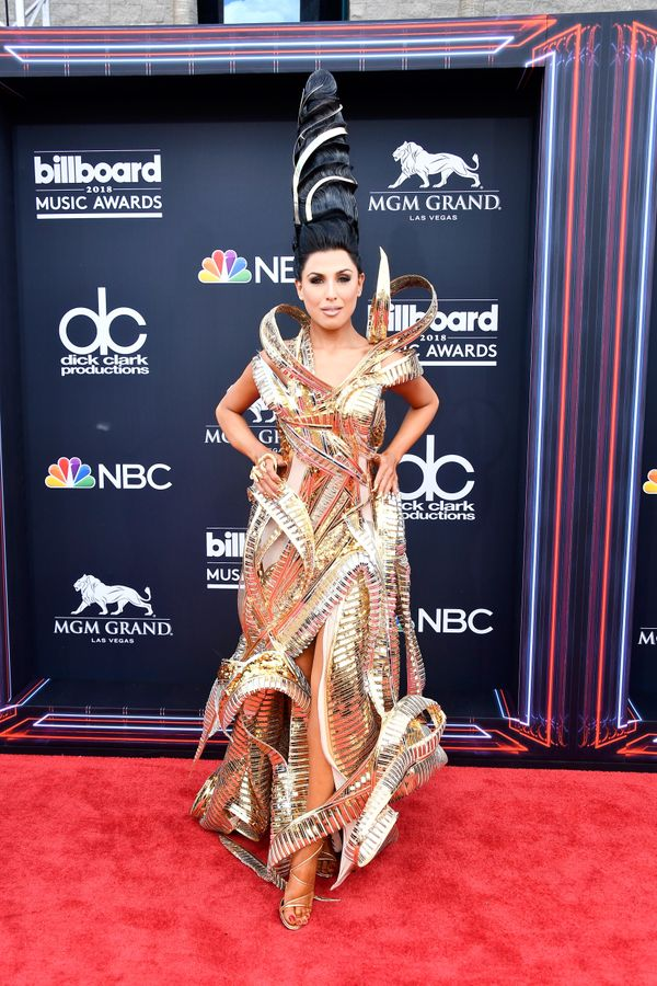 Recording artist Z LaLa never fails to deliver on a wild red carpet outfit. This gold look was no exception.