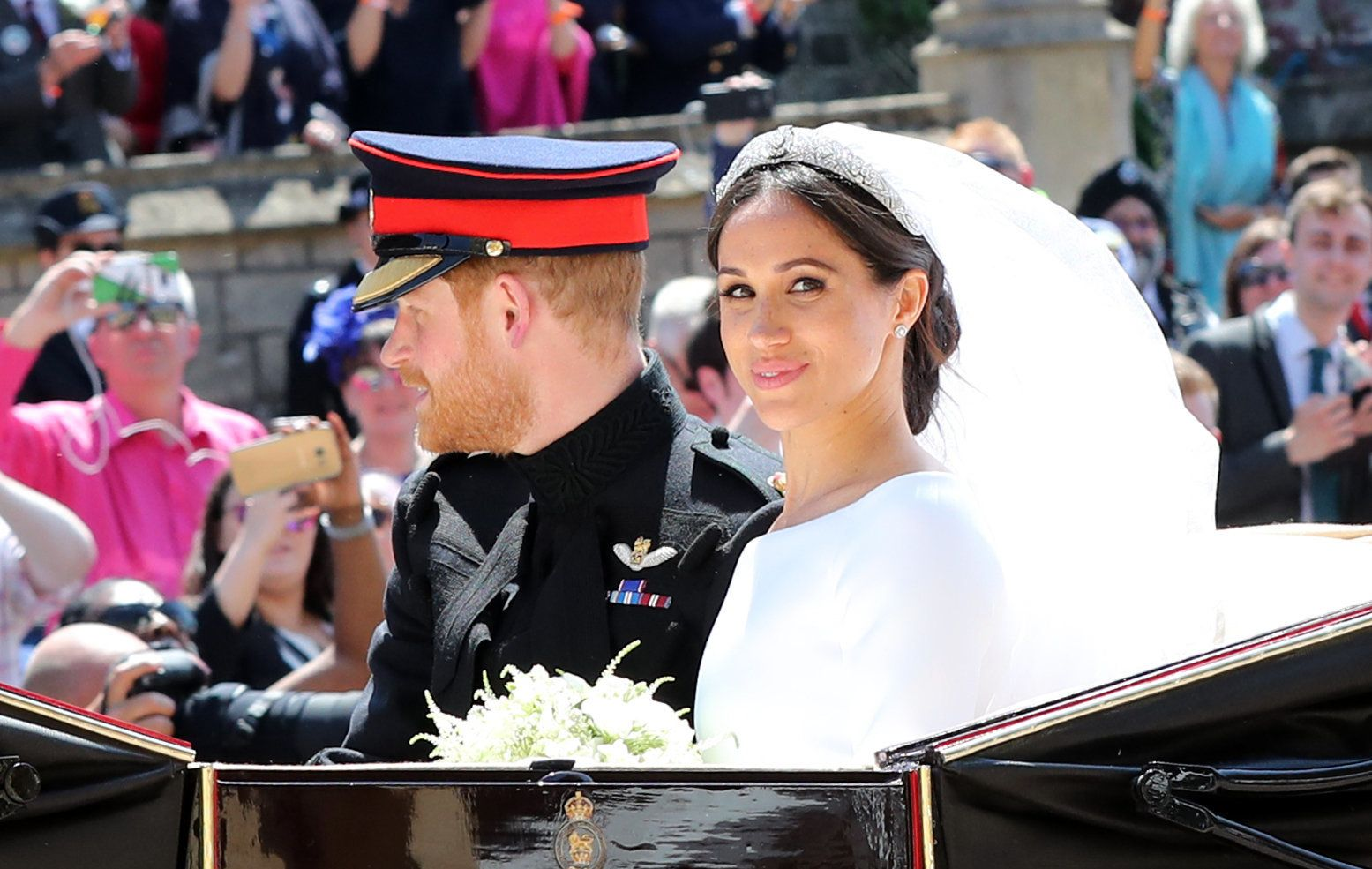 WINDSOR, ENGLAND - MAY 19:  Prince Harry, Duke of Sussex and The Duchess of Sussex leave Windsor Castle in the Ascot Landau carriage during a procession after getting married at St Georges Chapel on May 19, 2018 in Windsor, England.  (Photo by Gareth Fuller - WPA/Getty Images)