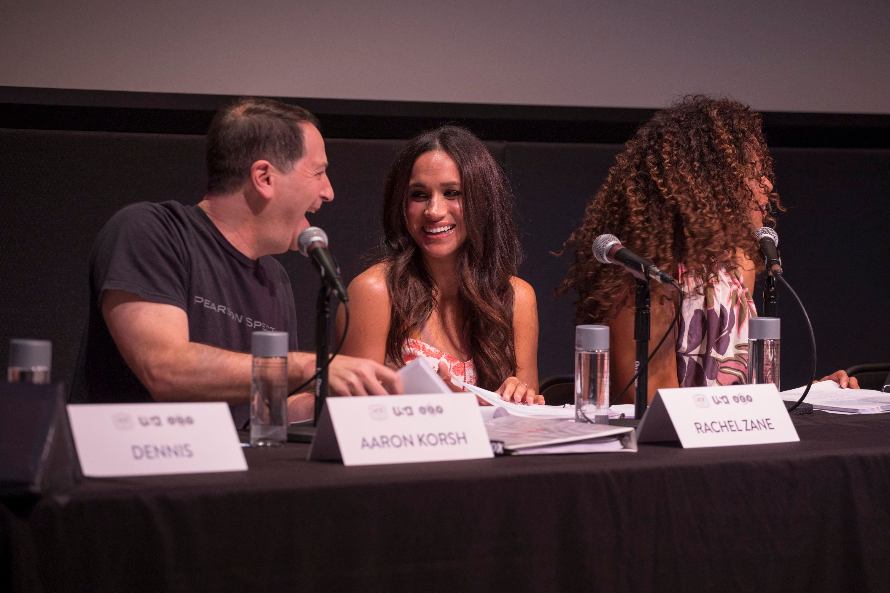 SUITS -- Script Reading Presented by USA Network -- Pictured: (l-r) Aaron Korsh, Meghan Markle, Gina Torres -- (Photo by: Rick Kern/USA Network/NBCU Photo Bank via Getty Images)