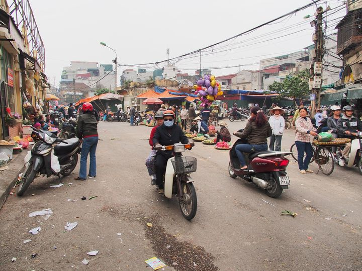 A motorcyclist wears a mask to block the smog in Hanoi.