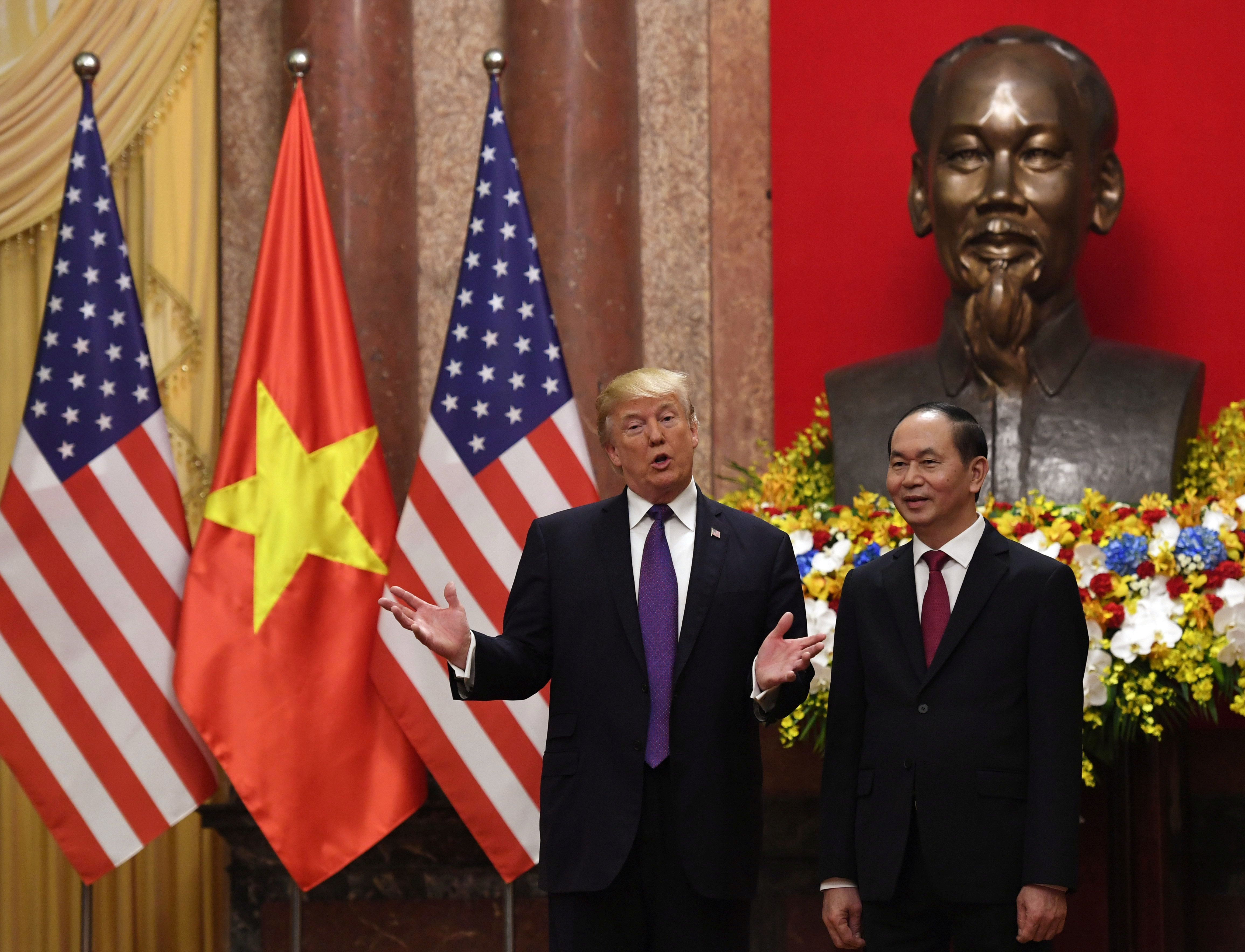 U.S. President Donald Trump poses with VietnamesePresident Trần Đại Quang during a welcoming ceremony at the Presidenti