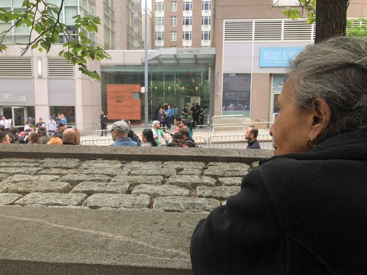 The author's abuela watches the protest outside Schlossberg's apartment building.
