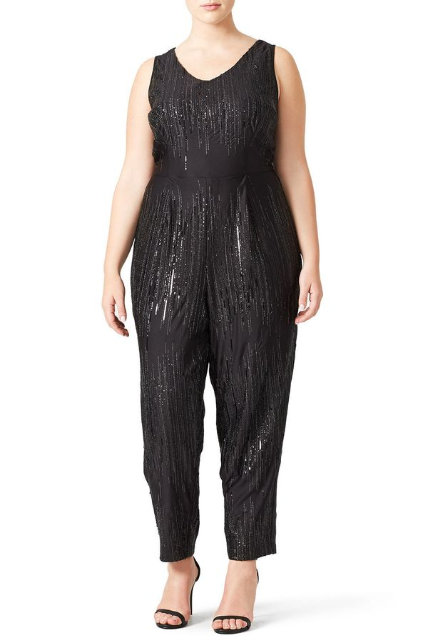 "<strong>Sizes</strong>: 14W to 22W<br>Get it <a href=""https://www.renttherunway.com/shop/designers/eloquii/esme_jumpsuit"" tar"