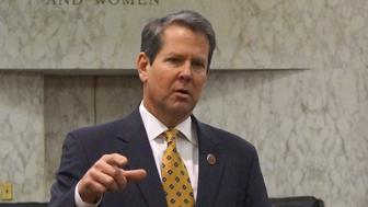"Georgia Secretary of State Brian Kemp speaks with visitors to the state capitol about the ""SEC primary"" involving a group of southern states voting next month in Atlanta, Georgia February 24, 2016. Candidates have campaigned more in the South this election year in an effort to woo a group of states voting early on so-called Super Tuesday than Kemp can recall seeing in any contemporary primary. And the seven states holding contests in the region appear poised to play a pivotal role in selecting the Republican and Democratic nominees for the November 8 race. Picture taken February 24, 2016. REUTERS/Letitia Stein"