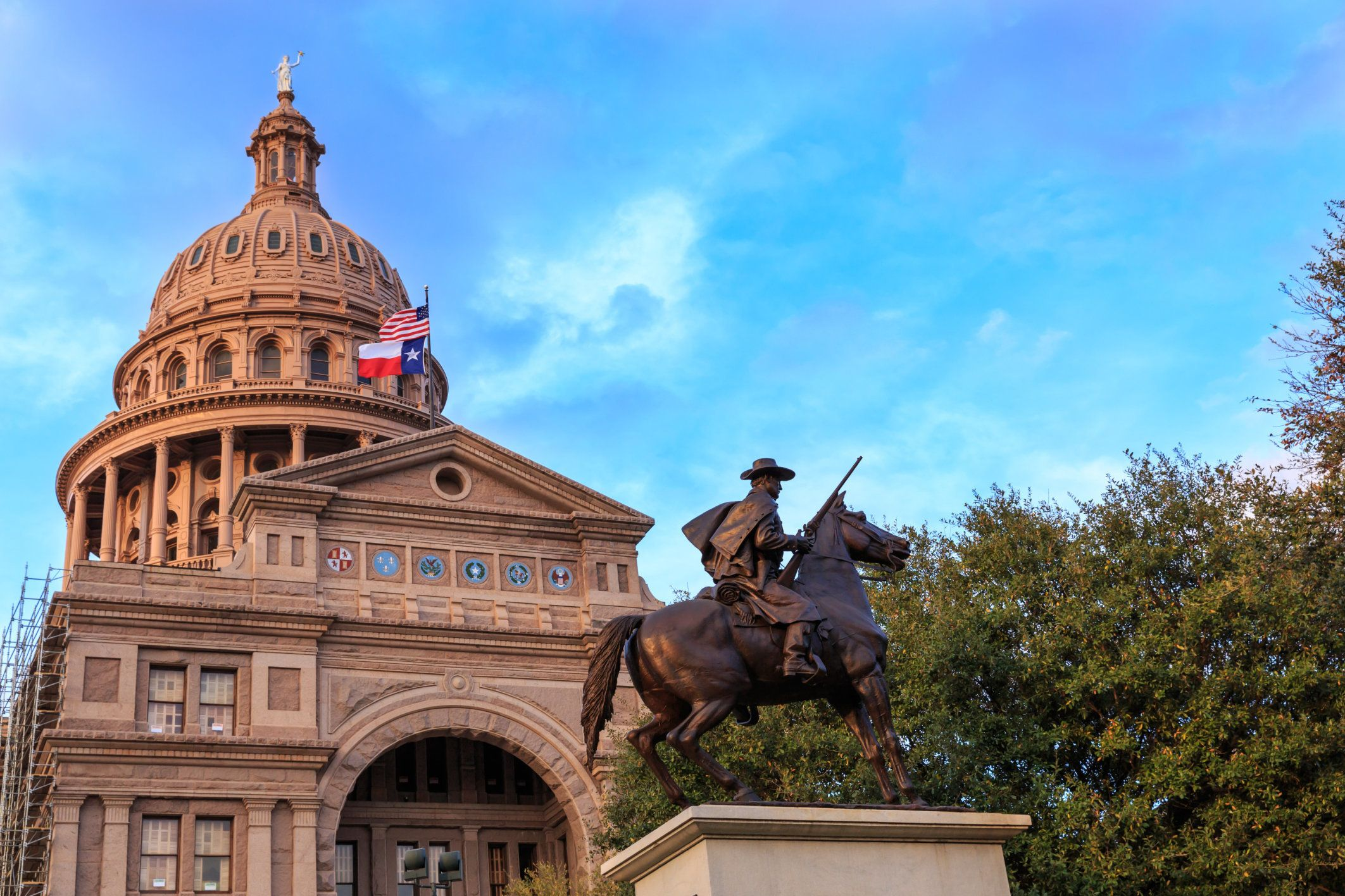 The Texas Ranger statue in front of the Texas Capital building in Austin, TX