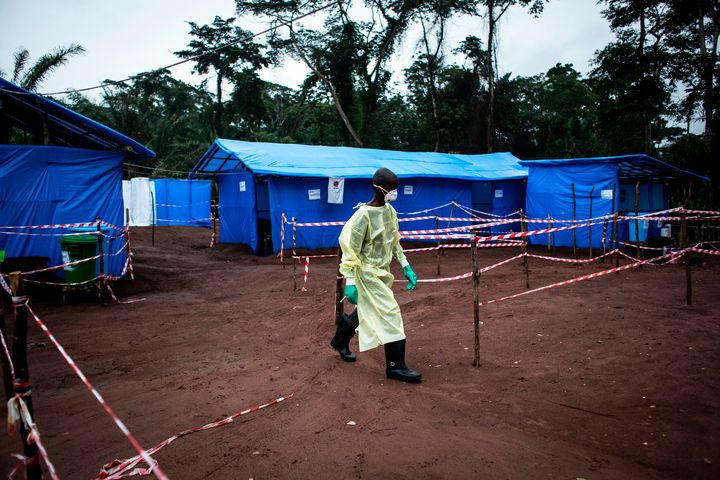 A health worker walks through an Ebola quarantine unit on June 13, 2017, in the village of Muma, after a case of Ebola was co