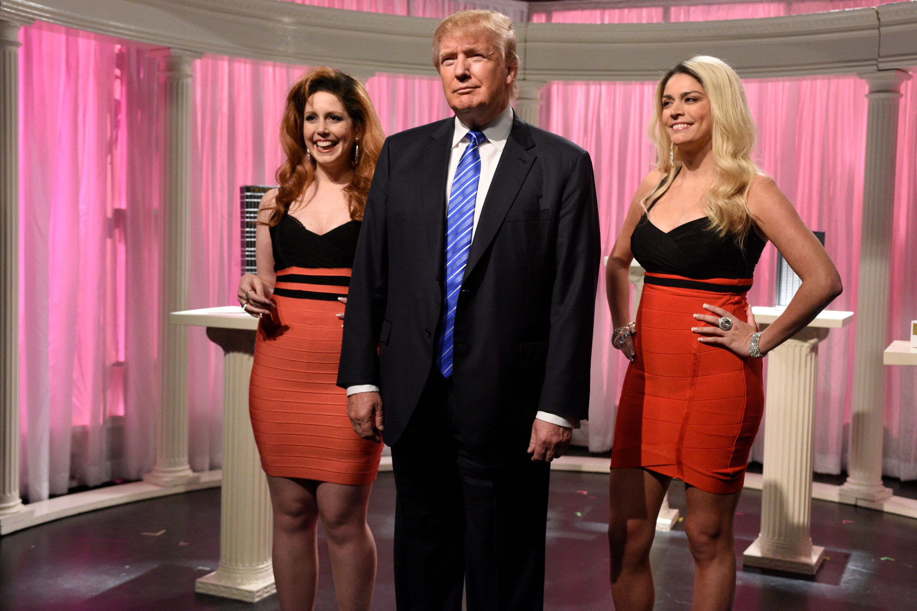 SATURDAY NIGHT LIVE -- 'Donald Trump' Episode 1687 -- Pictured: (l-r) Vanessa Bayer, Donald Trump, and Cecily Strong during the 'Porn Stars' sketch on November 7, 2015 -- (Photo by: Dana Edelson/NBC/NBCU Photo Bank via Getty Images)