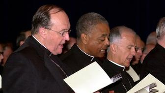 Bishop Philip Wilson (left), from Adelaide, Australia, Bishop Wilton D. Gregory of Belleville, Illinois (center) and Bishop Dale J. Melczek (right), from Gary, Indiana gather for a morning prayer service on the last day of the United States Conference of Catholic Bishops June 15, 2002 in Dallas, Texas. REUTERS/Amy E. Conn  AEC