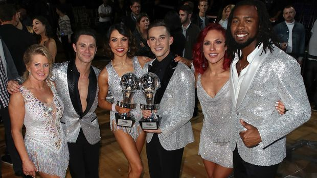 LOS ANGELES, CA - MAY 21:  (L-R) Figure skater Tonya Harding, dancer/TV personality Sasha Farber, Mirrorball trophy winners dancer/TV personality Jenna Johnson and figure skater Adam Rippon, and dancer/TV personality Sharna Burgess and NFL player Josh Norman pose at ABC's 'Dancing with the Stars: Athletes' Season 26 - Finale on May 21, 2018 in Los Angeles, California.  (Photo by David Livingston/Getty Images)