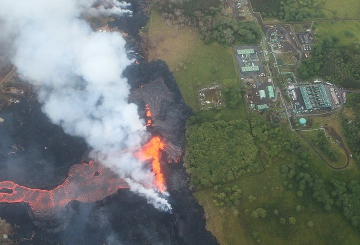 Lava erupts and flows from a Kilauea volcano fissure, near the Puna Geothermal Venture plant, on May 21.