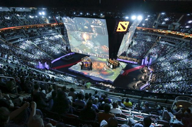 Fans watch a competition during The International Dota 2 Championships at Key Arena in Seattle, Washington...