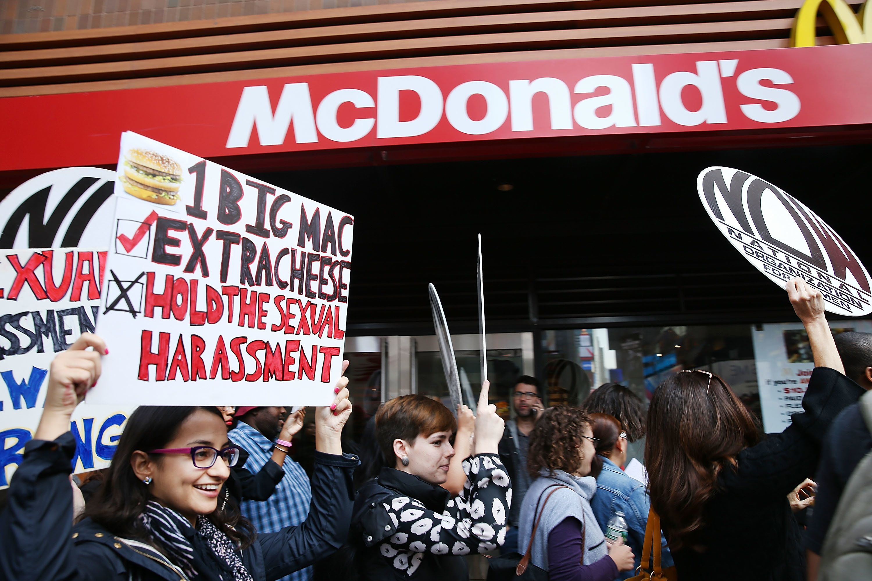 NEW YORK, NY - OCTOBER 06:  Protesters demonstrate outside of a McDonald's restaurant near Times Square after charges were brought against the company that they have ignored serious instances of sexual harassment on October 6, 2016 in New York City. According to 15 separate complaints that restaurant cooks, cashiers and other employees  filed with a federal agency over the past month, workers encountered numerous incidents of sexual harassment at some McDonald's restaurants.  (Photo by Spencer Platt/Getty Images)