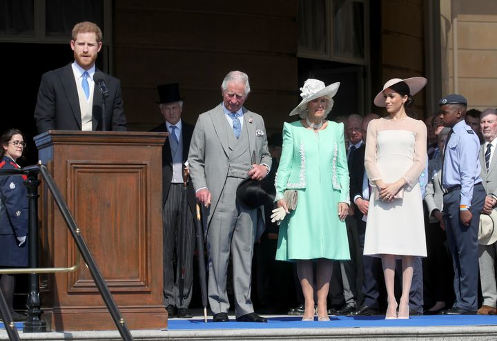 Prince Harry, Duke of Sussex, giving a speech next to Prince Charles, Camilla, Duchess of Cornwall and Meghan, Duchess of Sussex.