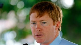 Florida Commissioner of Agriculture Adam Putnam speaks at a news conference about successes in attempts to eradicate the Giant African Land Snail in Miami, Florida August 29, 2013. In the two years since the snail was discovered in Miami-Dade County, officials say they have detected and eliminated 128,000 of the snails. The snails are considered one of the most damaging in the world because they consume at least 500 types of plants and can cause damage to buildings and carry dangerous parasites. REUTERS/Joe Skipper  (UNITED STATES - Tags: ANIMALS AGRICULTURE)