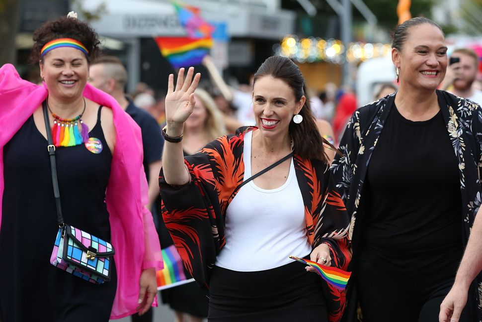 New Zealand Prime Minister Jacinda Ardern, center, is the first prime minister to walk in the Pride Parade on Feb. 17, 2018 i