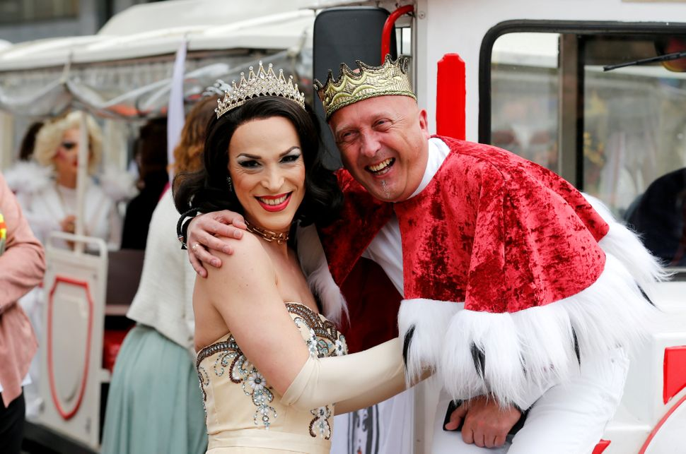 Participants dressed in royal wedding costumes are seen during the annual Belgian LGBTQ Pride Parade in central Brussels.