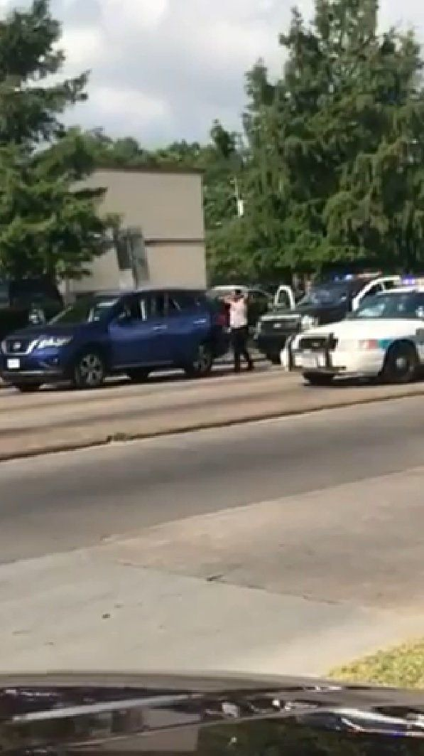 An officer in Houston Texas was filmed on May 19 ordering a woman to put her hands up saying Pretend like were going to shoot you