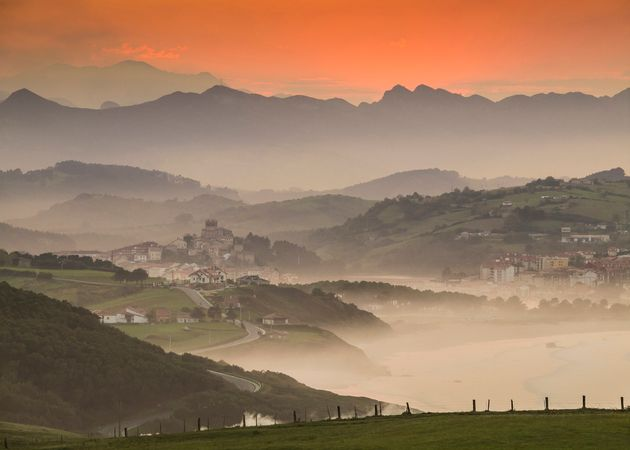 Mist rises as the sun sets on San Vicente de la Barquera, one of Cantabria's many picturesque towns. Cantabria's...