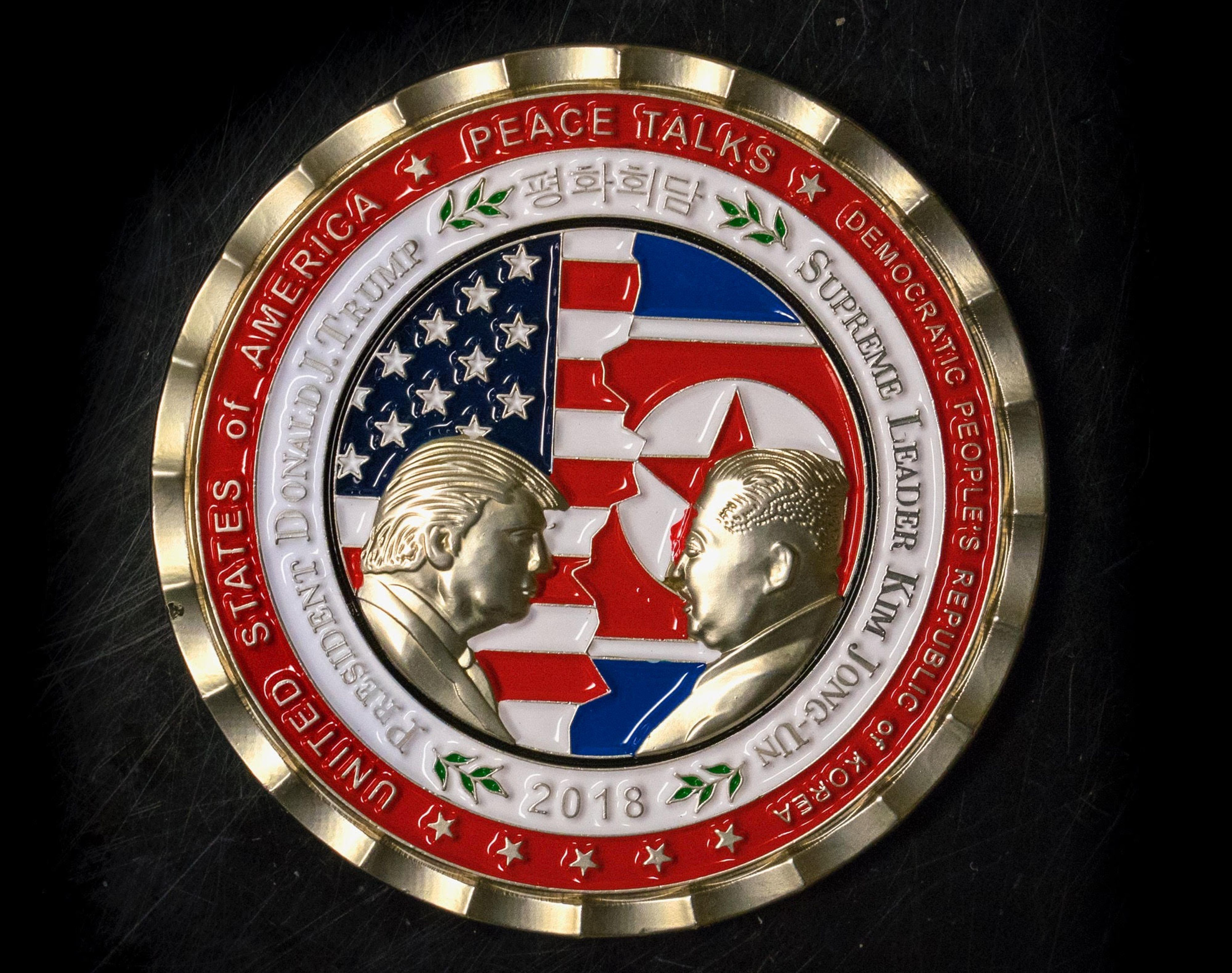 A coin released by the White House to celebrate a planned U.S.-North Korea summit. The talks' status and