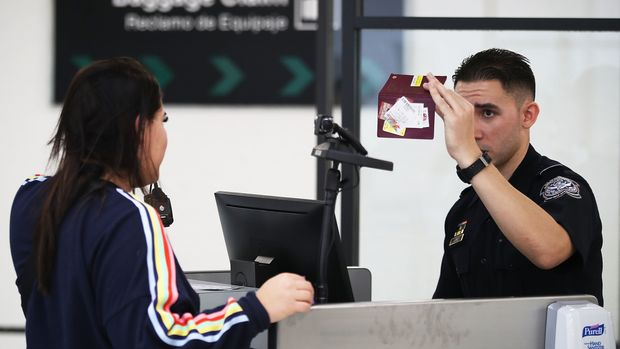 MIAMI, FL - FEBRUARY 27:  A U.S. Customs and Border Protection officer uses facial recognition technology in his booth at Miami International Airport to screen a traveler entering the United States on February 27, 2018 in Miami, Florida.  The facility is the first in the country that is dedicated to providing expedited passport screening via facial recognition technology, which verifies a traveler's identity by matching them to the document they are presenting.  (Photo by Joe Raedle/Getty Images)