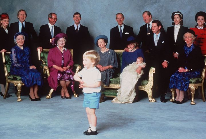 Prince Harry was christened at Windsor Castle on Dec. 21, 1984. In this official photo, he and his mother are surrounded by royal relatives and godparents amused at the antics of young Prince William.
