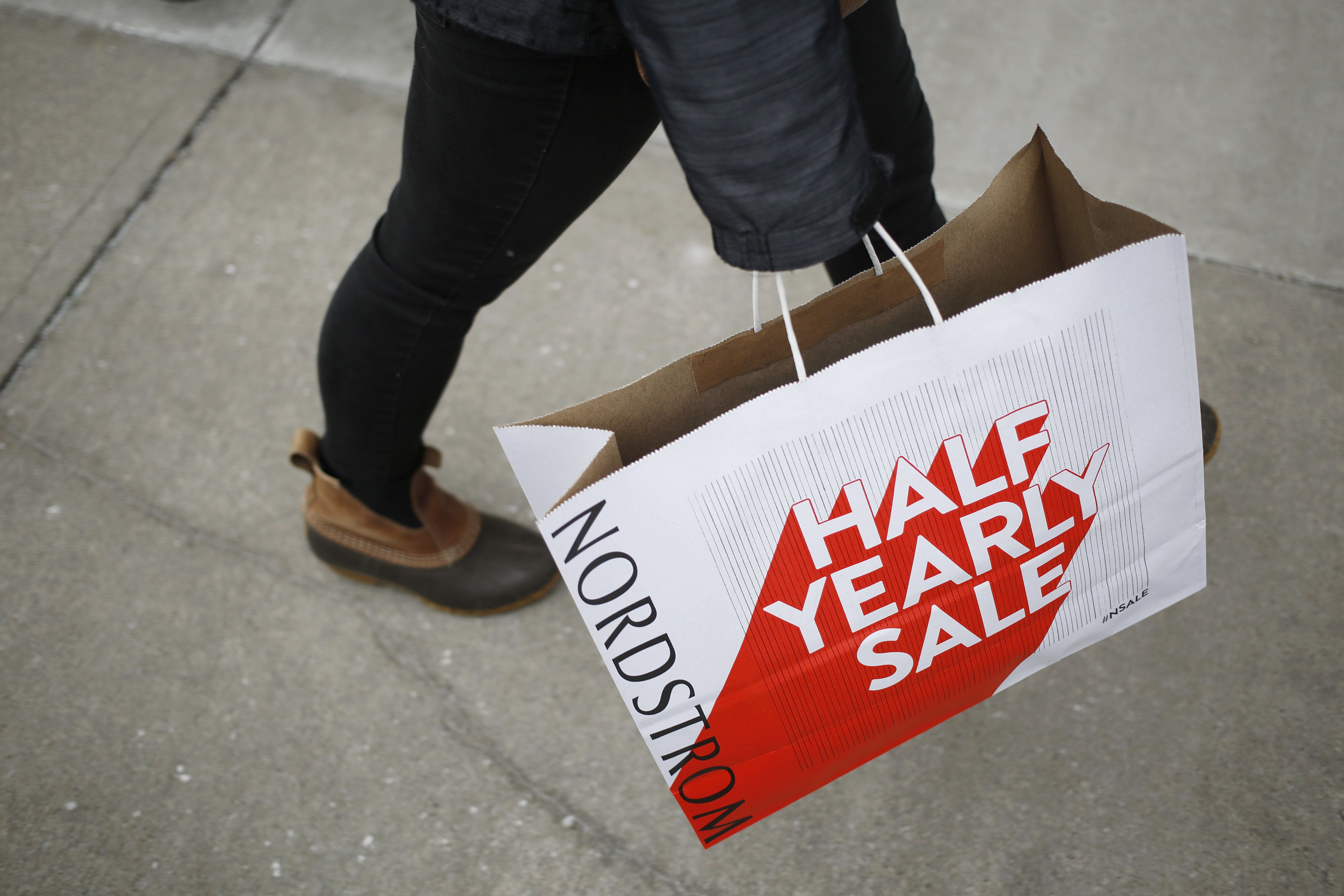 A shopper carries a Nordstrom Inc. bag at the Easton Town Center Mall in Columbus, Ohio, U.S., on Tuesday, Dec. 26, 2017. Americans displayed their buying bona fides in the final run-up to Christmas, turning out in force to produce what may be the best holiday shopping season in years. Photographer: Luke Sharrett/Bloomberg via Getty Images