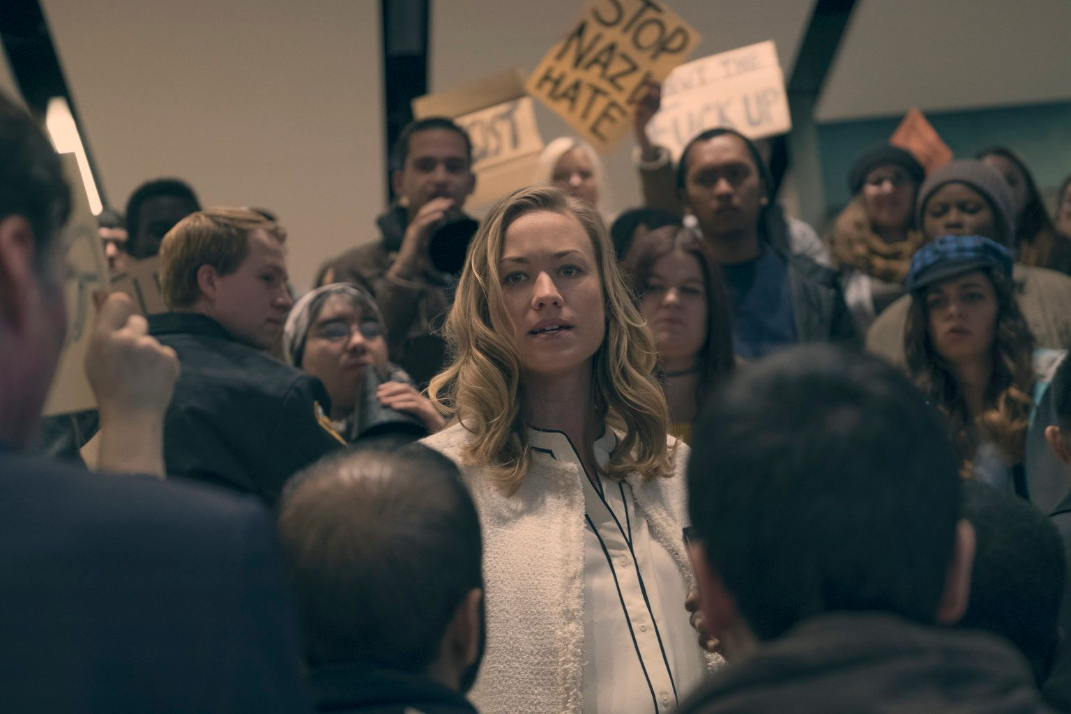"Serena Joy faces protesters in a ""Handmaid's Tale"" flashback."