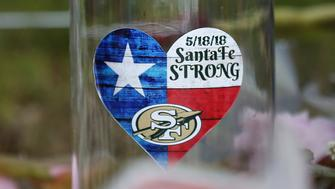 A sticker is seen at a makeshift memorial left in memory of the victims killed in a shooting at the Santa Fe High School in Santa Fe, Texas, U.S., May 22, 2018. REUTERS/Jonathan Bachman