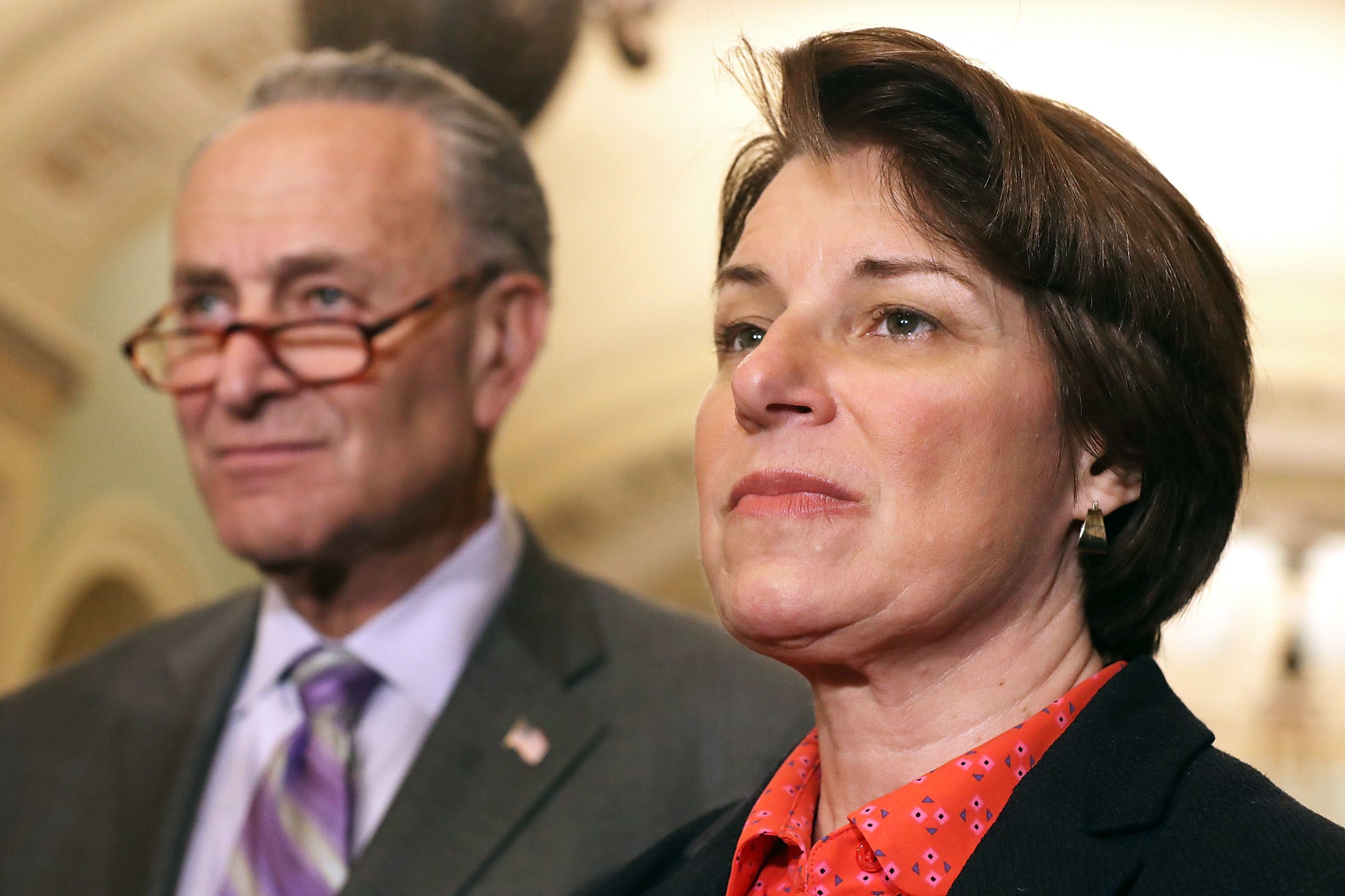 WASHINGTON, DC - MAY 22:  Sen. Amy Klobuchar (D-MN) (R) talks to reporters with Senate Minority Leader Charles Schumer (D-NY) following the weekly Senate Democratic policy luncheon at the U.S. Capitol May 22, 2018 in Washington, DC. Senate Republicans and Democrats said are close to advancing legislation that would reform the reporting process for victims of sexual harassment and would make members of Congress personally liable for any settlements.  (Photo by Chip Somodevilla/Getty Images)