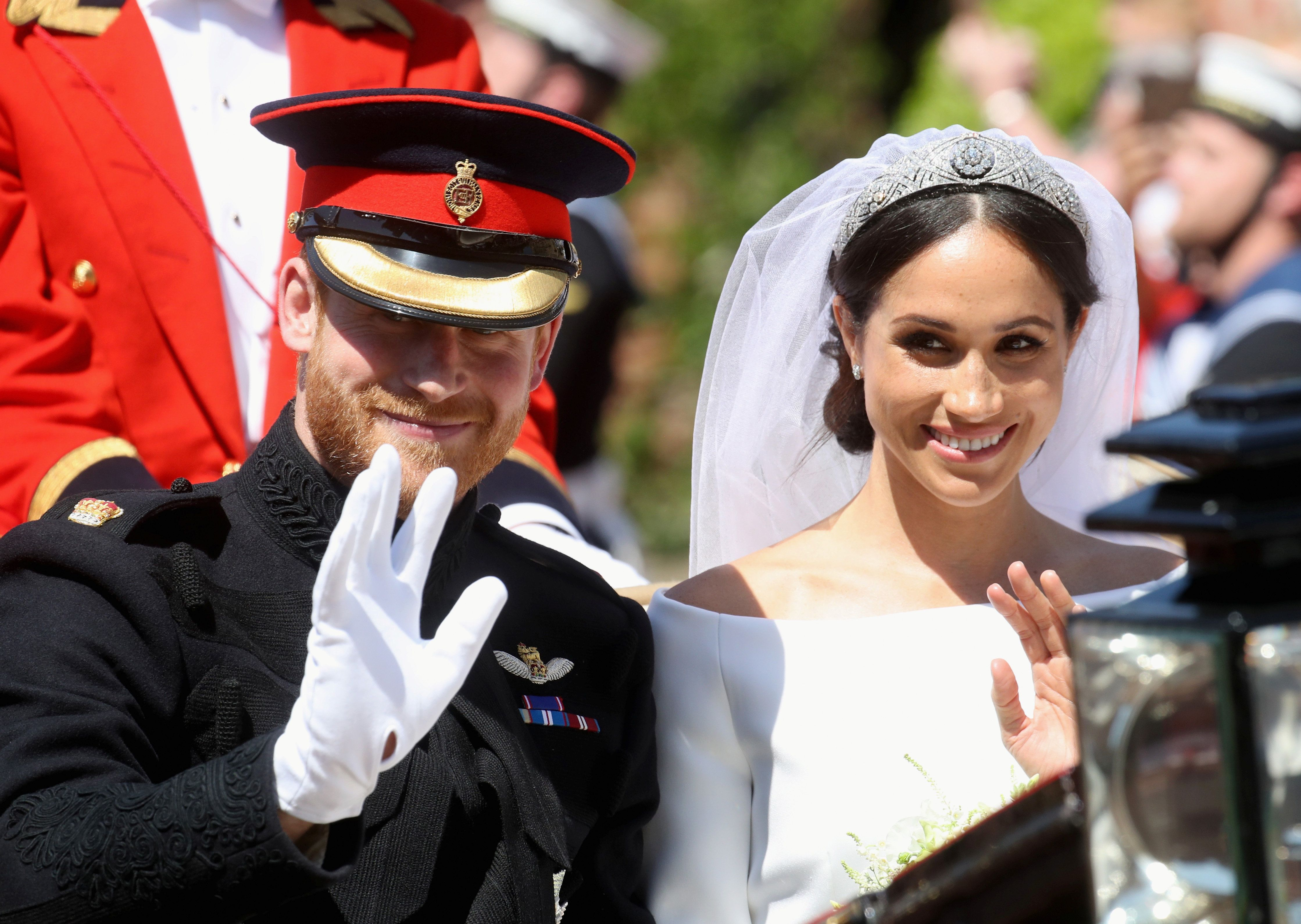 Prince Harry, Duke of Sussex and Meghan, Duchess of Sussex leave Windsor Castle in the Ascot Landau carriage during a procession after getting married at St Georges Chapel on May 19, 2018 in Windsor, England. Prince Henry Charles Albert David of Wales marries Ms. Meghan Markle in a service at St George's Chapel inside the grounds of Windsor Castle. Among the guests were 2200 members of the public, the royal family and Ms. Markle's Mother Doria Ragland.  Chris Jackson/Pool via REUTERS