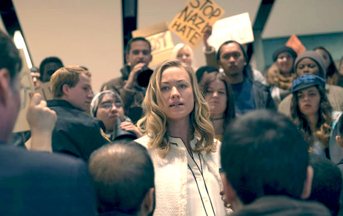 Serena Joy faces protesters in a Handmaids Tale flashback