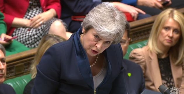 Prime Minister Theresa May speaks during Prime Minister's Questions in the House of Commons,