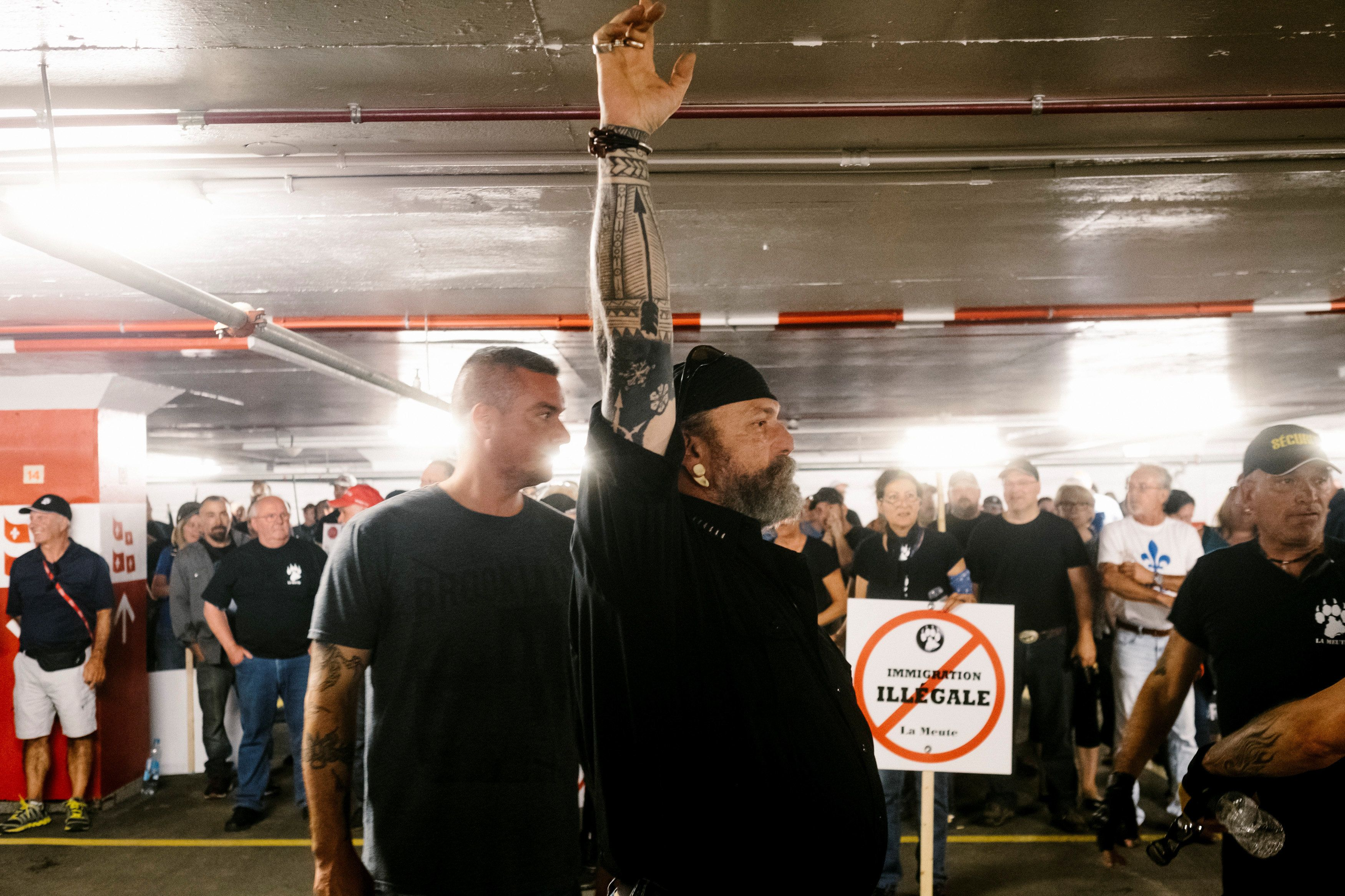 Patrick Beaudry, founder and leader of Quebec group La Meute who were marching to demand stronger border controls, waits in a parking garage due to the presence of counter-protesters outside, in Quebec City, Quebec, Canada August 20, 2017. REUTERS/Renaud Philippe