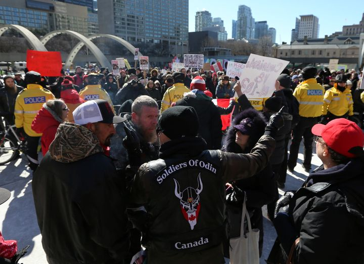 Members of the Soldiers of Odin Canada are faced by counter-protesters as they attend a rally.