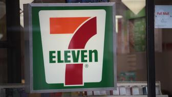 CHICAGO, IL - JANUARY 10:  A sign hangs outside of a 7-Eleven store on January 10, 2018 in Chicago, Illinois. Immigration officials raided nearly 100 7-Eleven stores across the country this morning checking the immigration status of store employees.  (Photo by Scott Olson/Getty Images)