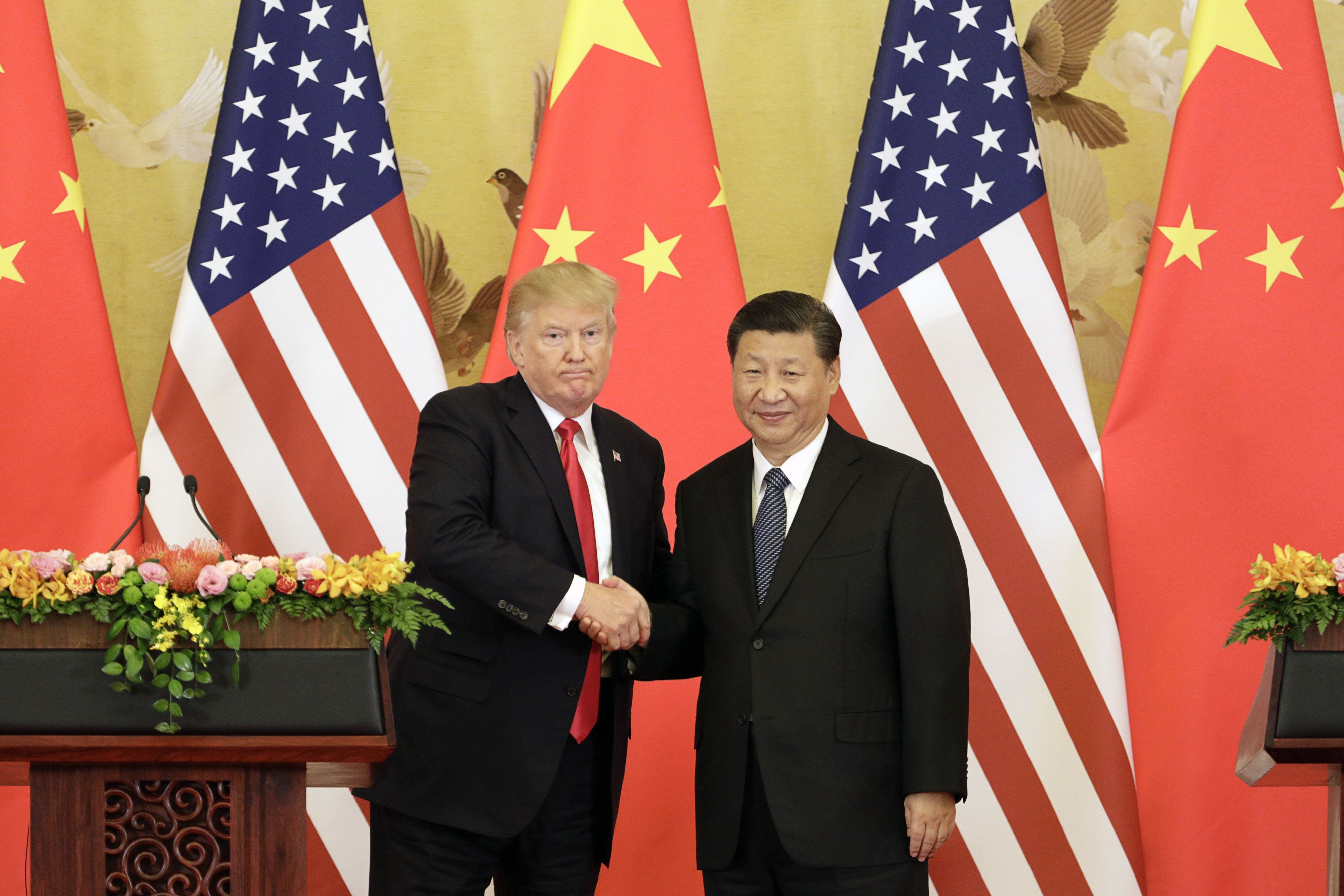 FILE: U.S. President Donald Trump, left, and Xi Jinping, China's president, shake hands during a news conference at the Great Hall of the People in Beijing, China, on Thursday, Nov. 9, 2017. The one year anniversary of U.S. President Donald Trump's inauguration falls on Saturday, January 20, 2018. Our editors select the best archive images looking back over Trumps first year in office. Photographer: Qilai Shen/Bloomberg via Getty Images