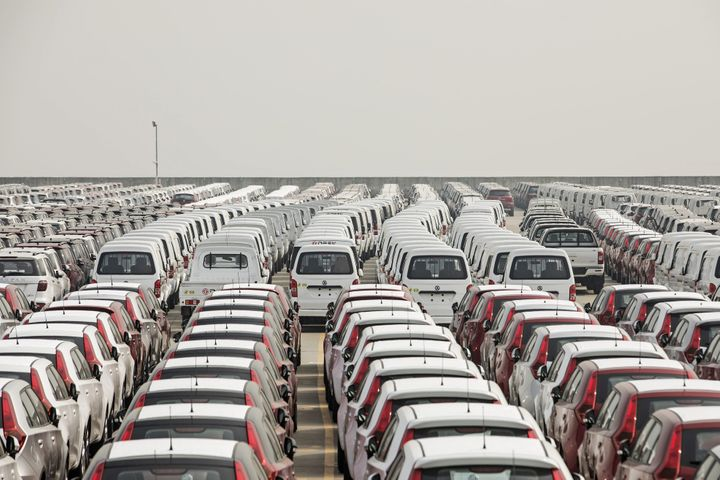 Vehicles stand at a port in Shanghai on April 30.