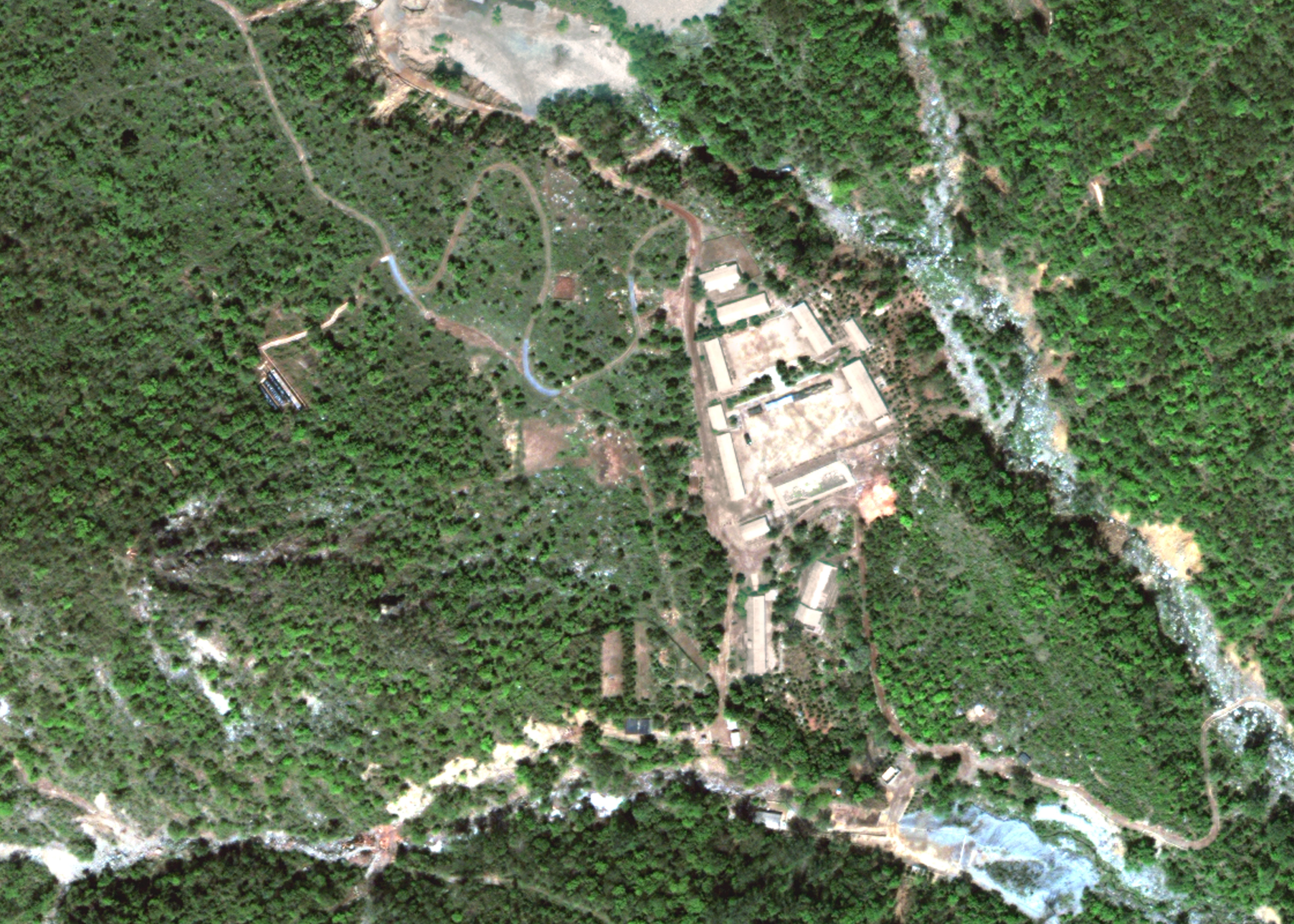 PUNGGYE-RI NUCLEAR TEST SITE, NORTH KOREA - MAY 23, 2018. DigitalGlobe satellite imagery of North Korea's Punggye-ri nuclear test site.  (Photo DigitalGlobe via Getty Images)