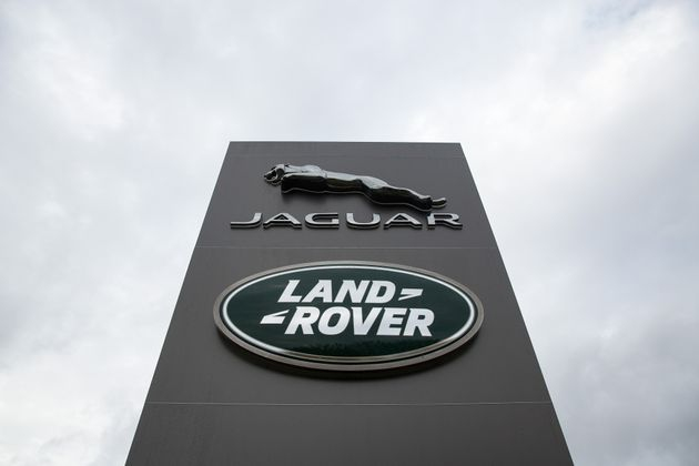 A logo sits outside the Jaguar Land Rover vehicle manufacturing plant in Solihull, West